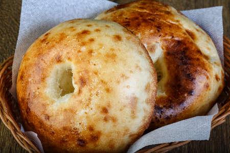 uzbek: Traditional Uzbek bread on the wood background