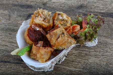 eatable: Fried spring rolls in eatable basket with salad leaves