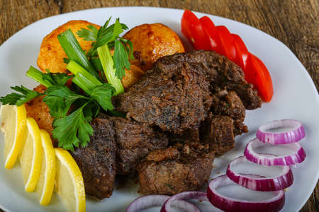 Hot juicy grilled liver with potato