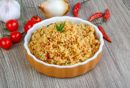Arabic traditional cuisine - Couscous with tomato and green onion