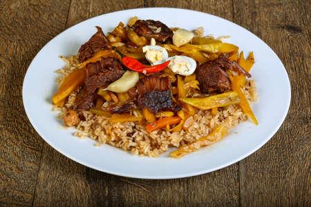 uzbek: Rice with beef - Uzbek traditional cuisine Stock Photo