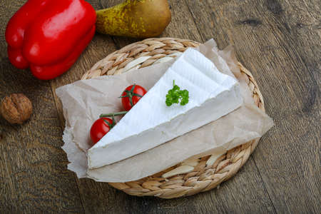 brie: Brie cheese triangle with tomato and parsley