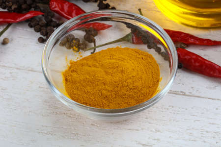 Madras: Curcuma powder in the bowl on wood background Stock Photo