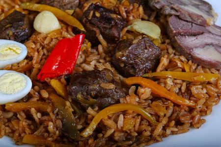 horseflesh: Rice with horsemeat, quail eggs an pepper Stock Photo