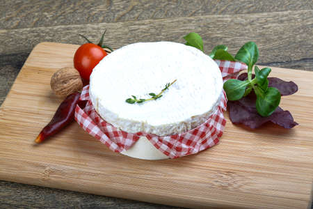 camembert: Camembert cheese with thyme and salad leaves Stock Photo