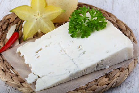 gorgonzola: Gorgonzola cheese with pear and parsley on the wood background