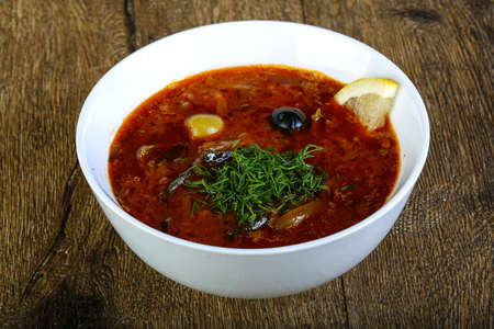 solyanka: Solyanka soup with lemon, olive and dill