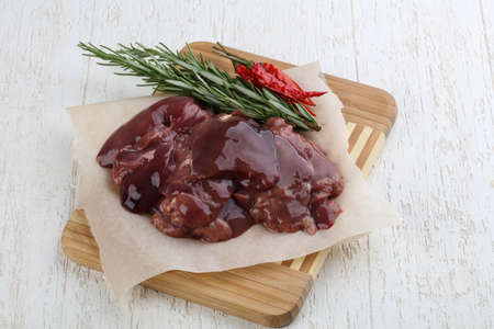 giblets: Raw chicken liver with spices ready for cooking