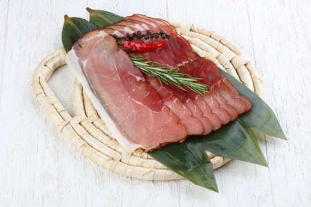 jamon: Famous Spain cuisine - pork Jamon with rosemary branch Stock Photo