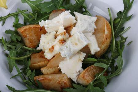 gorgonzola: Salad with gorgonzola, rucola and pear Stock Photo