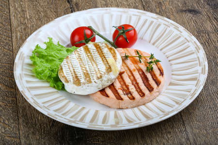 fresh food fish cake: Grilled fish salmon cutlet and camembert cheese Stock Photo