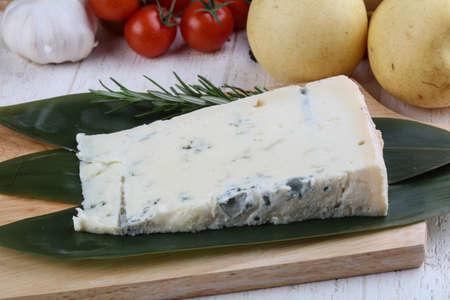 gorgonzola: Soft Gorgonzola cheese on the bamboo leaves with rosemary