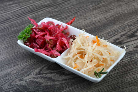 fermented: Viniagrette and fermented cabbage snacks with parsley Stock Photo