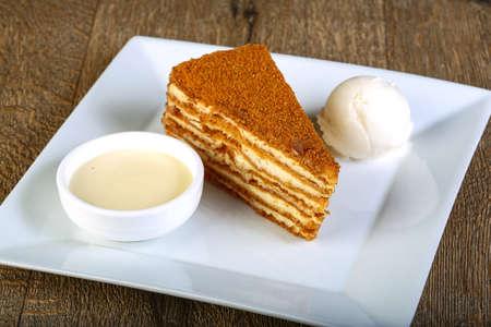 honey cake: Honey cake with ice cream scoop