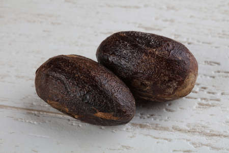 nutmeg: Nutmeg on the wood background - ready for cooking