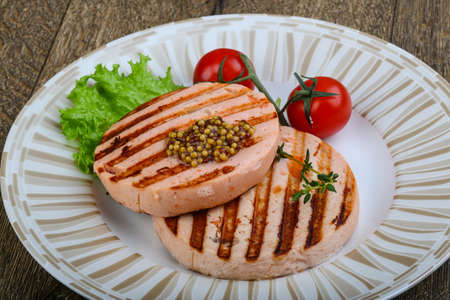 fresh food fish cake: Fishburger salmon grilled cutlet with mustard Stock Photo