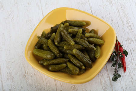 marinated gherkins: Small Pickled cucumbers on the wood background Stock Photo