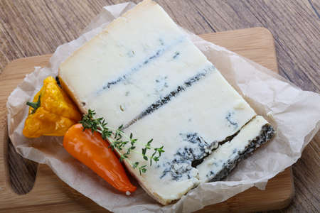 gorgonzola: Gorgonzola cheese on the board served thyme branch
