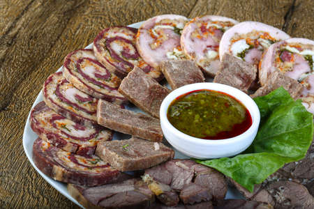 horseflesh: Horse sausages assortie with sauce and salad leaves Stock Photo