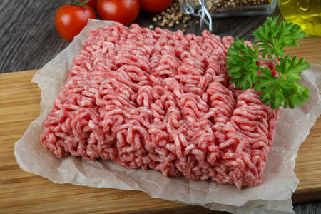 minced beef: Minced beef meat with parsley ready for cooking Stock Photo