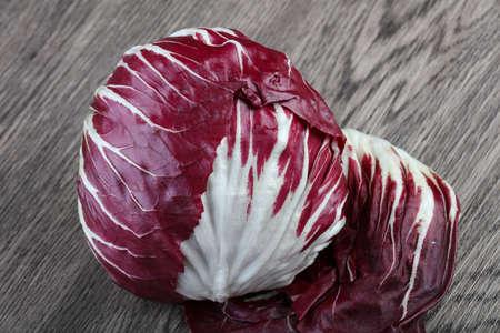 radicchio: Fresh Radicchio salad on the wood background