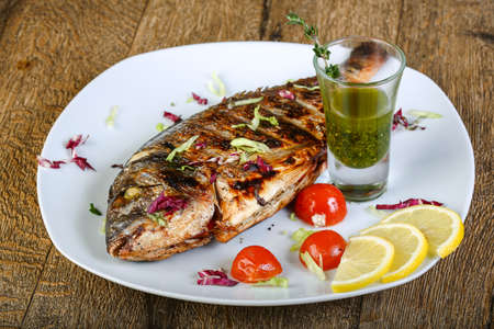 dorada: Grilled dorada with lemon, tomato and thyme sauce