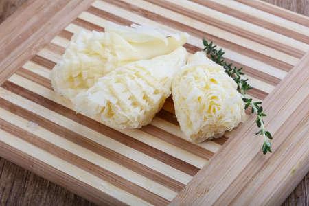 girolle: Cheese Tete de Moin with thyme branch Stock Photo