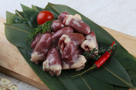 innards: Raw chicken hearts with pepper and thyme on the bamboo leaves