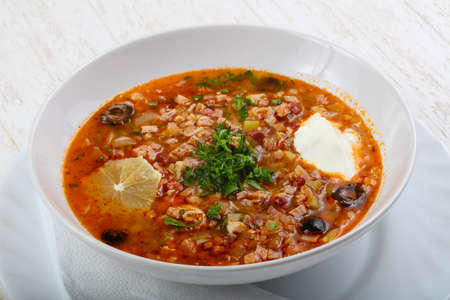 solyanka: Solyanka mix soup with sausages, olives and lemon
