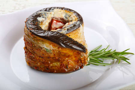 Stuffed eggplant with tomato and rosemary branch