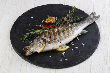 seabass: Grilled seabass with mustard, thyme and rosemary Stock Photo