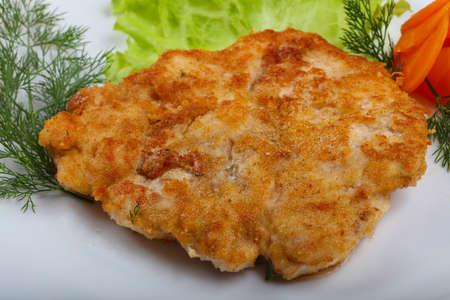 schnitzel: Chicken schnitzel served salad leaves and dill