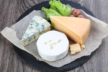 cheeseboard: Cheese plate with grape, cedar nut and salad