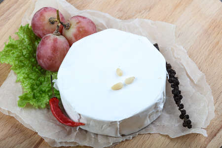 brie: Brie cheese with grape and cedar nuts