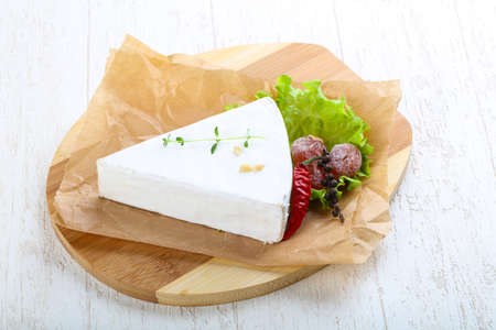 brie: Brie cheese with thyme and salad leaves Stock Photo