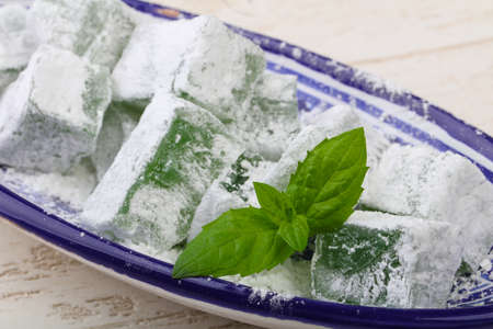 delight: Sweet Mint lukum delight in shugar powder Stock Photo