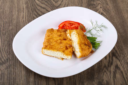 dill leaves: Baked cheese with dill leaves and tomato Stock Photo