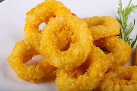 Fried Calamari rings with rosemary and lemon