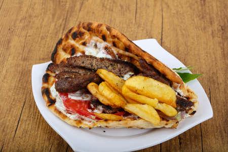 greek cuisine: Gyros - tradition Greek cuisine - pork with pita, potato and sauce