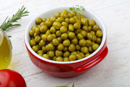 canned peas: Green canned peas in the bowl - ready for eat