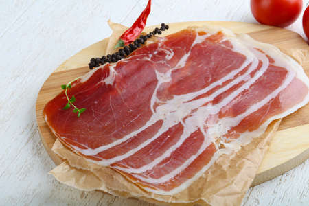 jamon: Jamon serrano with pepper and thyme leaves Stock Photo
