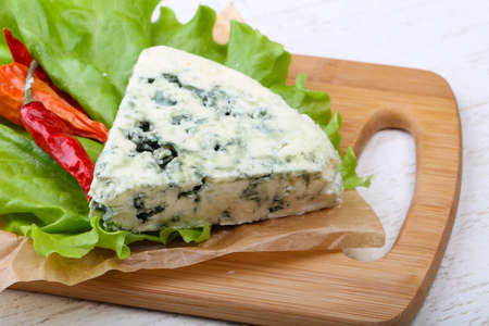roquefort: Roquefort cheese with pepper and salad leaves Stock Photo