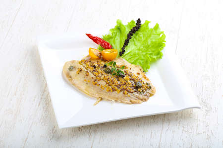 fish plate: Baked tilapia fish with mustard and pepper
