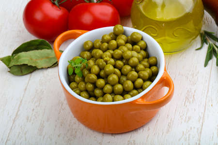 vegetable tin: Green canned peas in the bowl - ready for eat