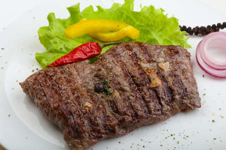 medium: Grilled beef steak with onion and pepper