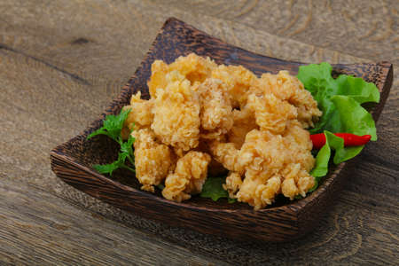 Crispy chicken nuggets with spices on wood background Stock Photo