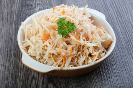 Fermented cabbage sauerkraut with carrot and pepper