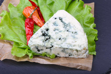 stilton: Roquefort cheese with pepper and salad leaves Stock Photo