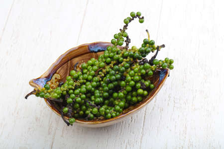 Green pepper corn on the branch in plate