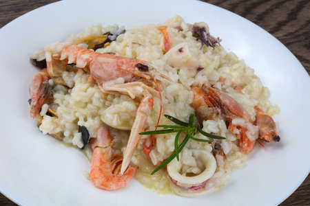 shrimp cocktail: Seafood mix risotto with rosemary leaves
